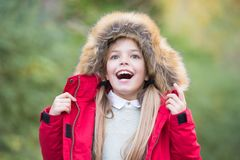 Child in red coat and hood with fur outdoor Royalty Free Stock Photo
