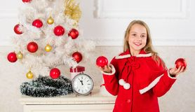 Child red costume hold christmas ornament ball. Christmas ball traditional decor. Top christmas decorating ideas for royalty free stock photography