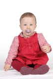 Child with red dress. Portrait of a girl with red dress and pacifier stock photos