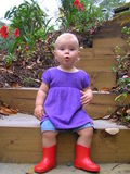 Child in red gumboots Stock Images
