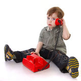 Child with red phone Royalty Free Stock Image