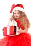 Child  in red santa hat holding gift box. Stock Photography