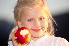 Child with red, sweet and healthy apple Stock Photography