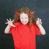 Child in red t-shirt with aggression  in pose. Royalty Free Stock Photos