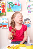 Child in red t-shirt painting. Royalty Free Stock Images