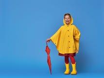 Child with red umbrella Stock Photo
