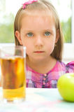 Child refuses to drink apple juice Stock Photos