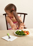 A child refuses to eat broccoli with meat Royalty Free Stock Image