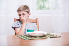 Child refusing to eat soup Royalty Free Stock Photo