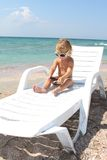 Child relaxing on beach Royalty Free Stock Photos