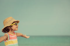 Child relaxing on the beach Royalty Free Stock Images
