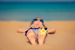 Child relaxing on the beach Stock Photography