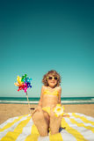Child relaxing on the beach Royalty Free Stock Image