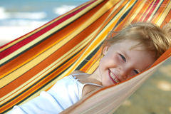 Child relaxing in a hammock Royalty Free Stock Image
