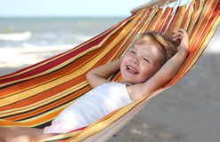 Child Relaxing In A Hammock Royalty Free Stock Images