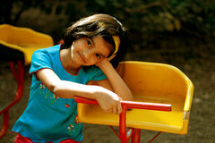 Child Relaxing In The Park Stock Photos