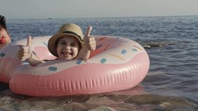 Child relaxing in sea on summer vacation