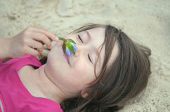 Child relaxing in nature Stock Images