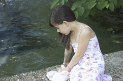 Child relaxing by pond royalty free stock images