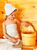 Child relaxing at sauna. Stock Image