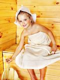 Child relaxing at sauna. Stock Photos