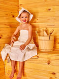 Child relaxing at sauna Royalty Free Stock Photography