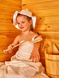 Child relaxing at sauna Royalty Free Stock Photo