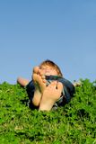 Child relaxing sleeping outdoors stock photography