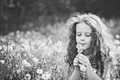 Child relaxing in a spring meadow. Stock Image