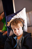 Child is relaxing and watching a film in an aircraft in business Royalty Free Stock Photos