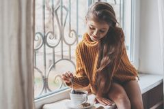 Child relaxing on a window sill Royalty Free Stock Photos