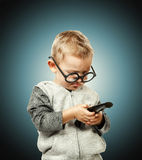 Child with remote control Royalty Free Stock Images