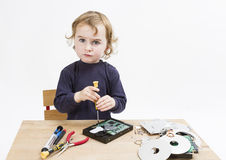 Child repairing computer part Royalty Free Stock Photos