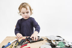 Child repairing computer part Royalty Free Stock Photography