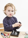 Child repairing computer part Royalty Free Stock Images