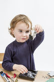Child repairing hard disk drive Royalty Free Stock Images