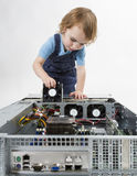 Child repairing network computer Royalty Free Stock Images