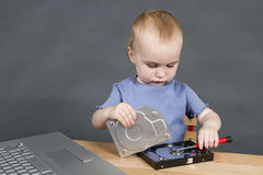 Child repairing open hard drive Stock Images