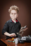 Child repairs digital cameras Stock Images