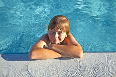 Child rest on his elbow at the edge. Happy child rest on his elbow at the edge of the pool with closed eyes Stock Image