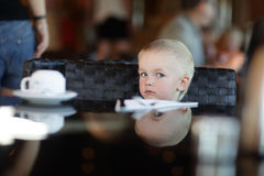 Child in a restaurant Stock Image