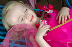 Child resting with butterfly net Royalty Free Stock Photo