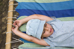 Child resting in hammock Stock Images