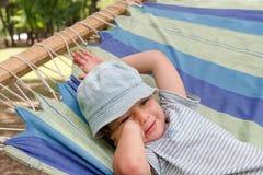Child resting in hammock Stock Photo