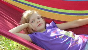 The child is resting on the hammock stock footage