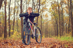 Child resting on his bike. After work out on bike Royalty Free Stock Photo