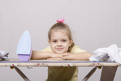 Child rests on the Ironing Stock Image