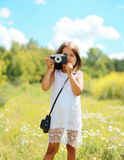 Child with retro camera in summer day. Outdoors Royalty Free Stock Photos