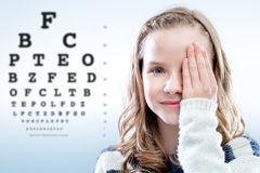Child reviewing eyesight. Royalty Free Stock Photos