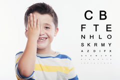 Child reviewing eyesight Stock Photos